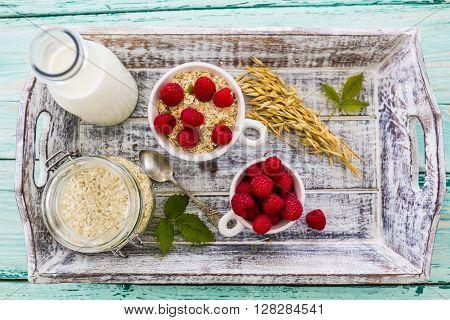 Porridge, Oatmeal with raspberry - traditional, healthy breakfast
