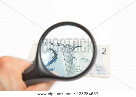 Magnifying Glass on the two Brasilian Reals