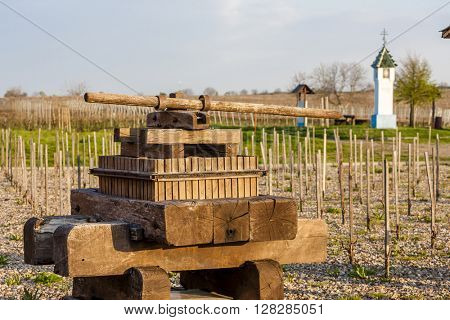 wine press and wayside with vineyard near Velke Bilovice, Czech Republic