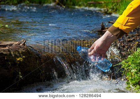 Man Taking Water From Forest On Hiking Trip02