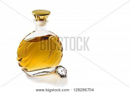 Bottle of whiskey and a wrist watch on a white background