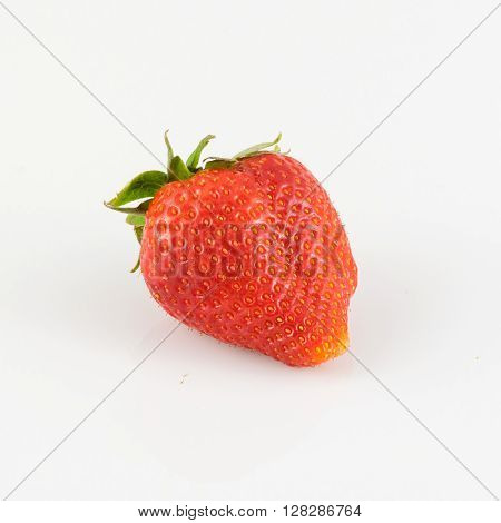 Closeup of strawberries on white lucid background