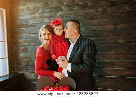 Happy Family And Daughter At Old Vintage Wooden House