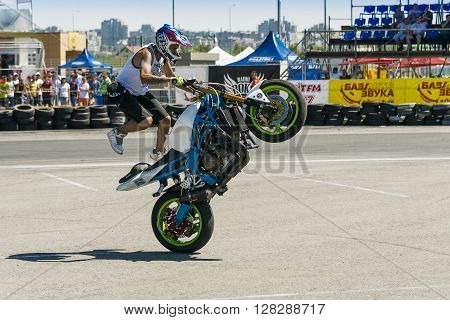 Lviv Ukraine - June 7 2015: Unknown stunt bikers entertain the audience before the start of the championship of drifting near Arena - Lviv stadium in Lviv Ukraine.