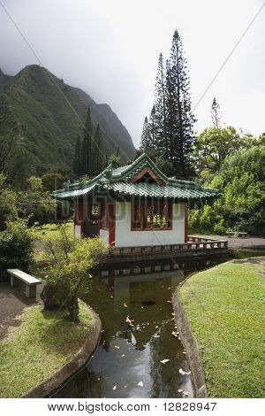 Scenic shot of a pagoda with stream in Iao Valley State Park in Maui, Hawaii.