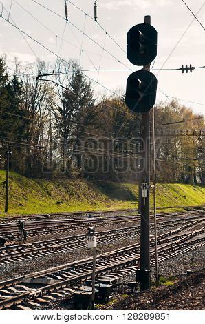 the empty railroad tracks and high semaphore in springtime