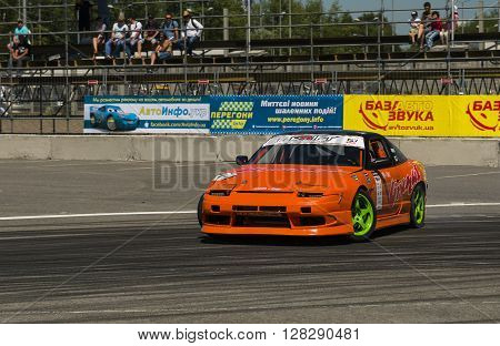 Lviv Ukraine - Juny 6 2015: Unknown rider on the car brand Nissan overcomes the track in the championship of Ukraine drifting in Lviv.