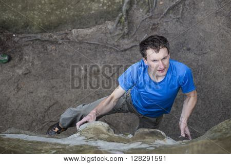 Athlete Climbs On Rock With Rope.