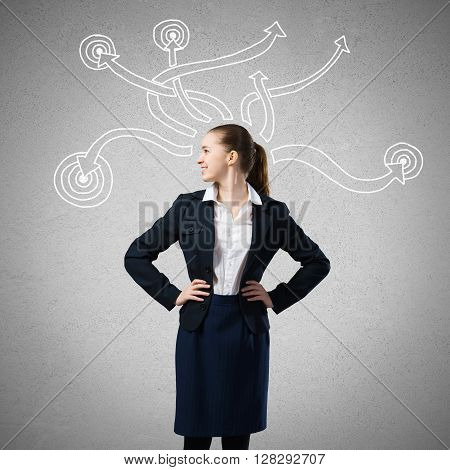 Thoughtful businesswoman and drawn arrow thoughts out of her head
