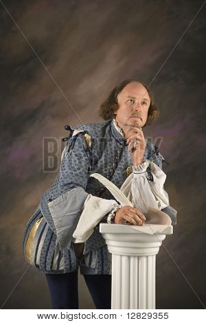 William Shakespeare in period clothing holding leaning on column with hand to chin in thoughtful expression.
