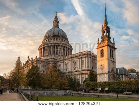 London United Kingdom - October 20 2015: View of St. Paul's cathedral in sunset rays. Unidentified people present on picture.