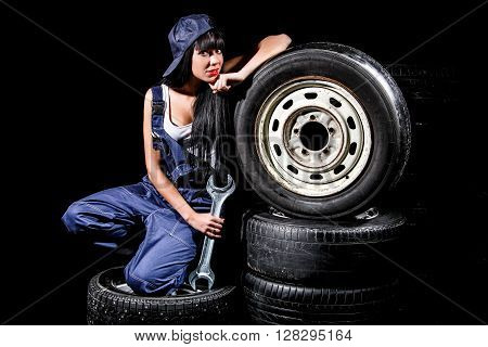 Woman Sitting On A Tires