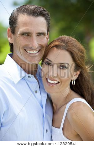 Successful Happy Middle Aged Man And Woman Couple Outside