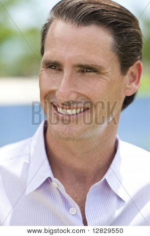 Outdoor Portrait Of Happy Handsome Middle Aged Man