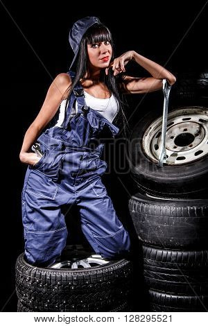 Woman In A Tire Service