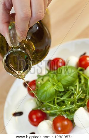 Olive Oil Dressing On Tomato Mozzarella Rocket & Basil Salad