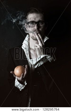 Smoking Man With An Orange In His Hand
