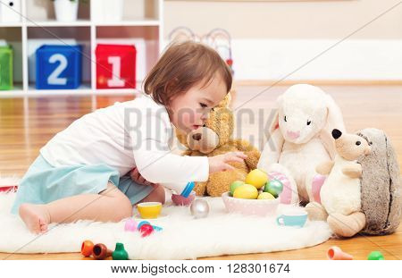 Toddler Girl Playing With Her Stuffed Animals