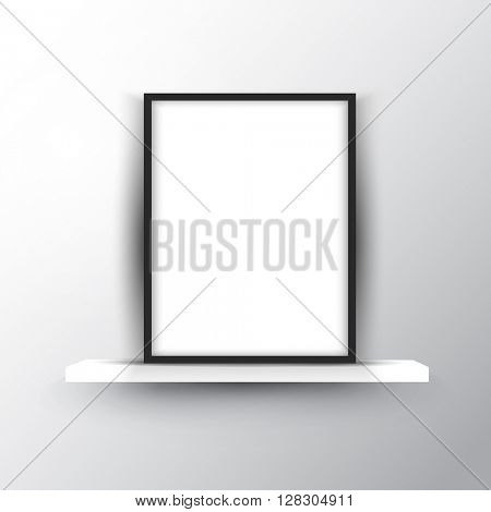 Blank picture frame on a shelf