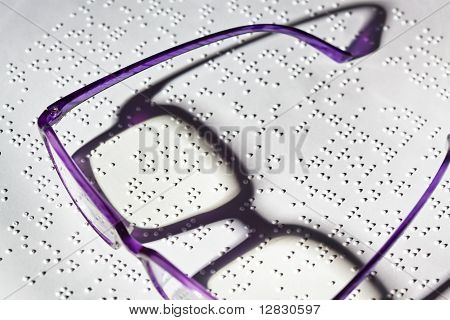 Glasses and book in Braille.
