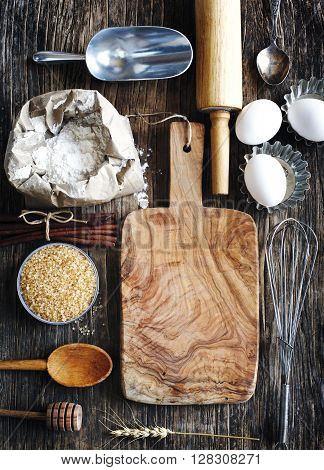 Vintage kitchen utensils props and ingredients on a rustic wooden table. Baking concept.