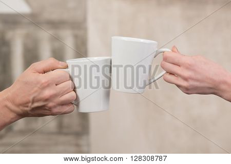 People holding cups of delicious coffee in office. Close-up of porcelain cups represented all together. Aroma concept.