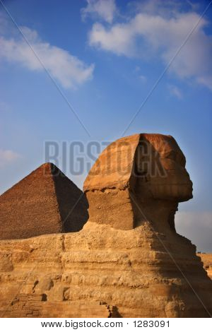 The Great Sphinx With The Great Pyramid In The Background