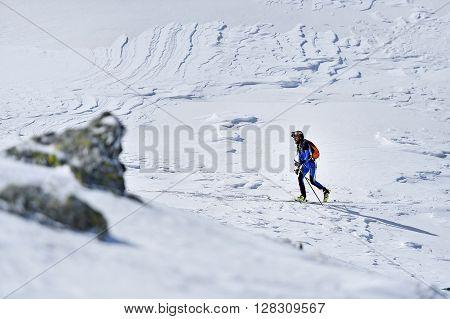 FAGARAS ROMANIA - MARCH 5: Ski mountaineer competes during the Ski Mountaineering National Competition in Fagaras Mountains on March 5 2016 in Romania.