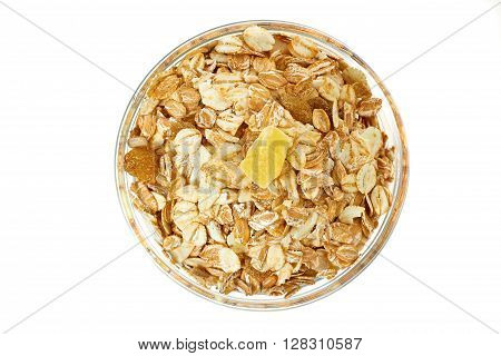 Muesli breakfast in glass bowl isolated on white background. Top view.