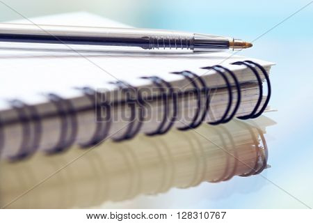 Open notebook with pen macro close up