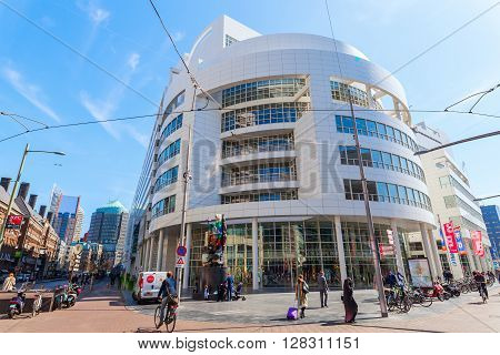 The Hague Netherlands - April 21 2016: New City Hall of The Hague with unidentified people. It was designed in 1986 by American architect Richard Meier and completed in 1995
