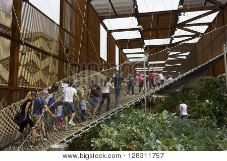 MILAN, ITALY - JUNE 29 2015: People walking on th suspended net at the external of Brazilian Pavilion of Expo 2015 Universal Exhibition in Milan Italy in June 29 2015