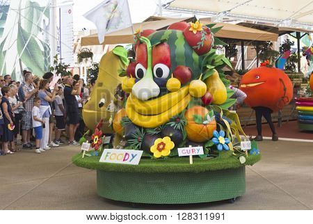 MILAN, ITALY - JUNE 29 2016: Foody Expo 2015 Mascotte during the parade through people in Milan on June 29 2015