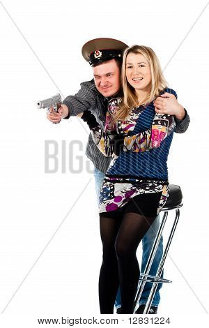 A Man Protecting A Woman With The Gun