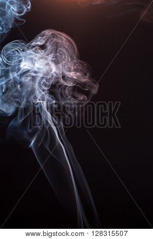 Beautiful smoke on the black background - macro photo.