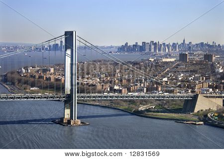 Aerial view of New York City's Verrazano-Narrow's bridge with Manhattan skyline.