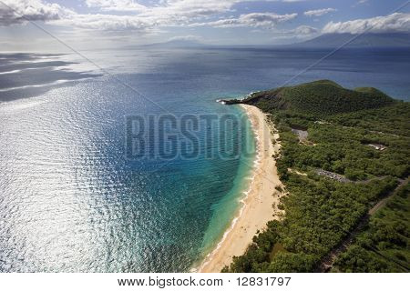 Aerial of coastline with sandy beach and Pacific ocean in Maui, Hawaii.