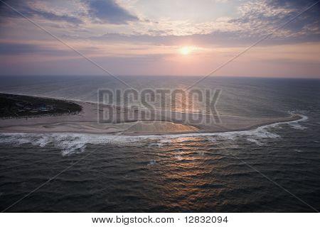 Scenic Bald Head Island North Carolina landscape of shoreline during sunrise.