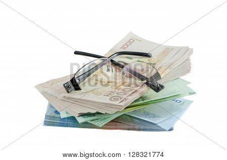 Broken black glasses on Thai baht money