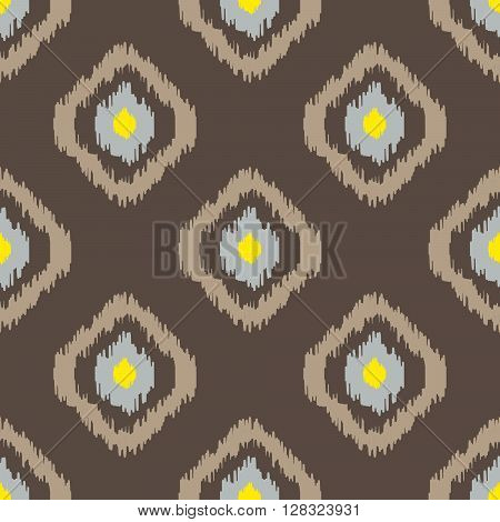 Ikat geometric seamless pattern. Yellow and brown color collection. Indonesian textile fabric tie-dye technique inspiration. Rhombus and drop shapes.