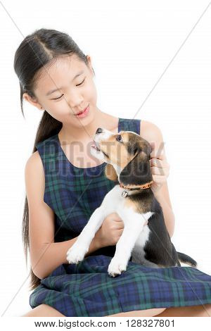 Happy Asian girl playing with beagle puppy on isolated background