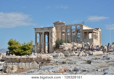 ATHENS, GREECE - OCTOBER 18: Erechtheion ancient greek temple dedicated to both Athena and Poseidon with the famous Porch of Caryatids at the top of the Acropolis of Athens OCTOBER 18, 2014 in Athens, Greece