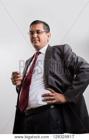 indian businessman holding ball pen and thinking, indian businessman thinking, asian businessman holding pen while deep thinking, indian businessman solving problem, isolated over white background