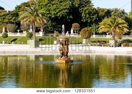 Color DSLR image of pond in Luxembourg Gardens, a popular Paris, Left Bank tourist attraction. Horizontal with copy space for text