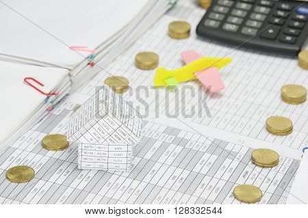House On Finance Have Blur Airplane And Calculator As Background