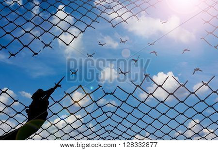 Silhouette Hand With Scissors Cutting Net With Sky Background, Freedom Concept Idea