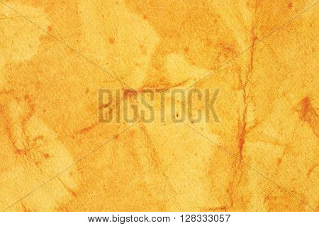 Yellow background with stains - texture decorative colored paper