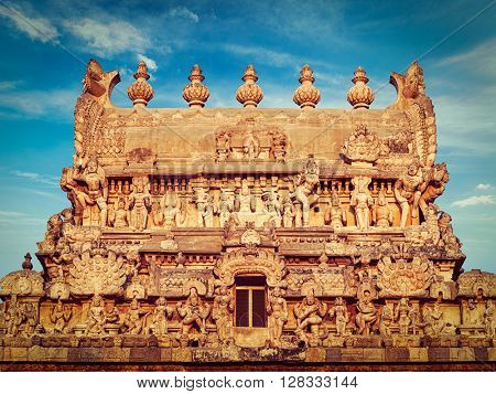 Vintage retro effect filtered hipster style image of entrance tower (gopura) of Periyanayaki Amman Temple against sky. Airavatesvara Temple, Darasuram, Tamil Nadu, India