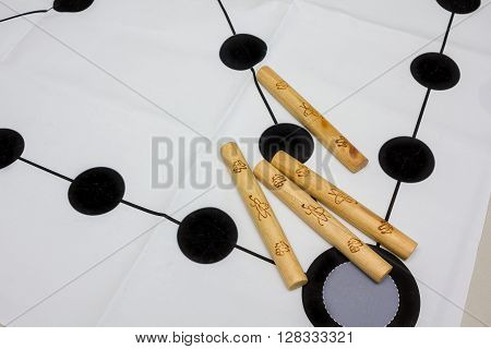 Korean traditional game yut nori game background and wooden sticks