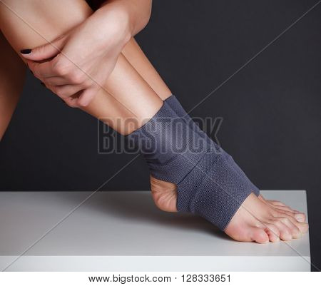Close-up portrait of beautiful women feet with yoga socks
